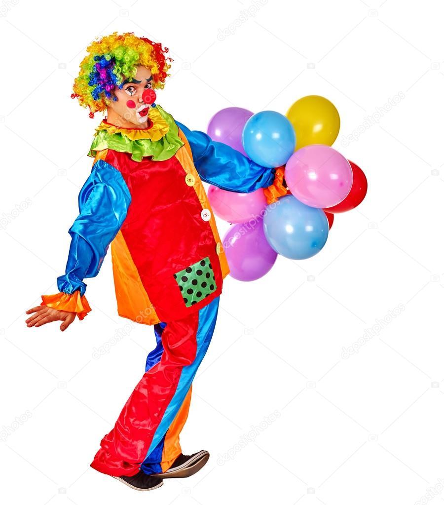 Happy birthday clown holding  bunch of balloons.