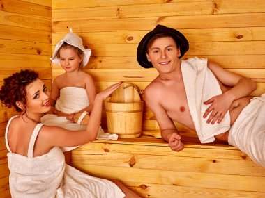 Family relaxing in the sauna.