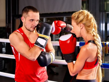Couple Man and Woman Boxing in Ring.