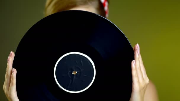Girl in style holding vinyl record.