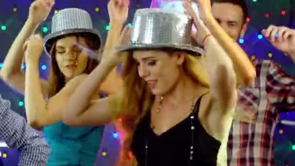 Girl with friends dancing in nightclub. 4k.
