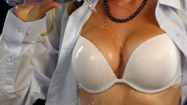 Unbutton her blouse
