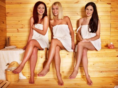 Women relaxing in sauna.