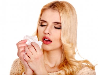 Ill woman with handkerchief