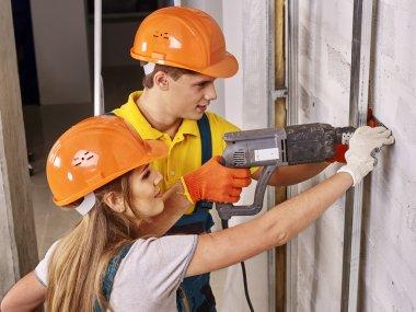 Family in builder uniform indoor.