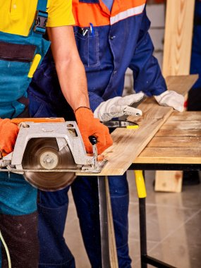 Builders with circular saw .