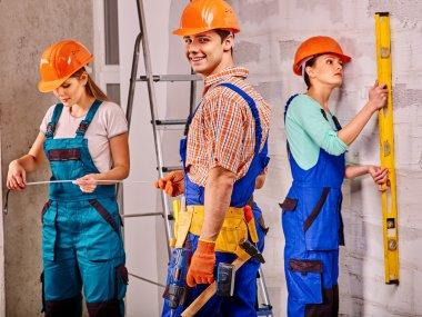 people in builder uniform.
