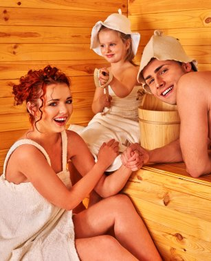 Family  in hats  at sauna.