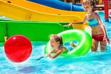 Children on water slide at aquapark.