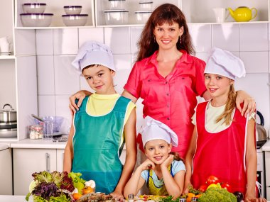 Mother with daughters and son cooking