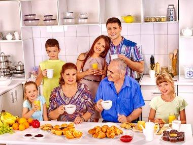 Big happy family have breakfast.