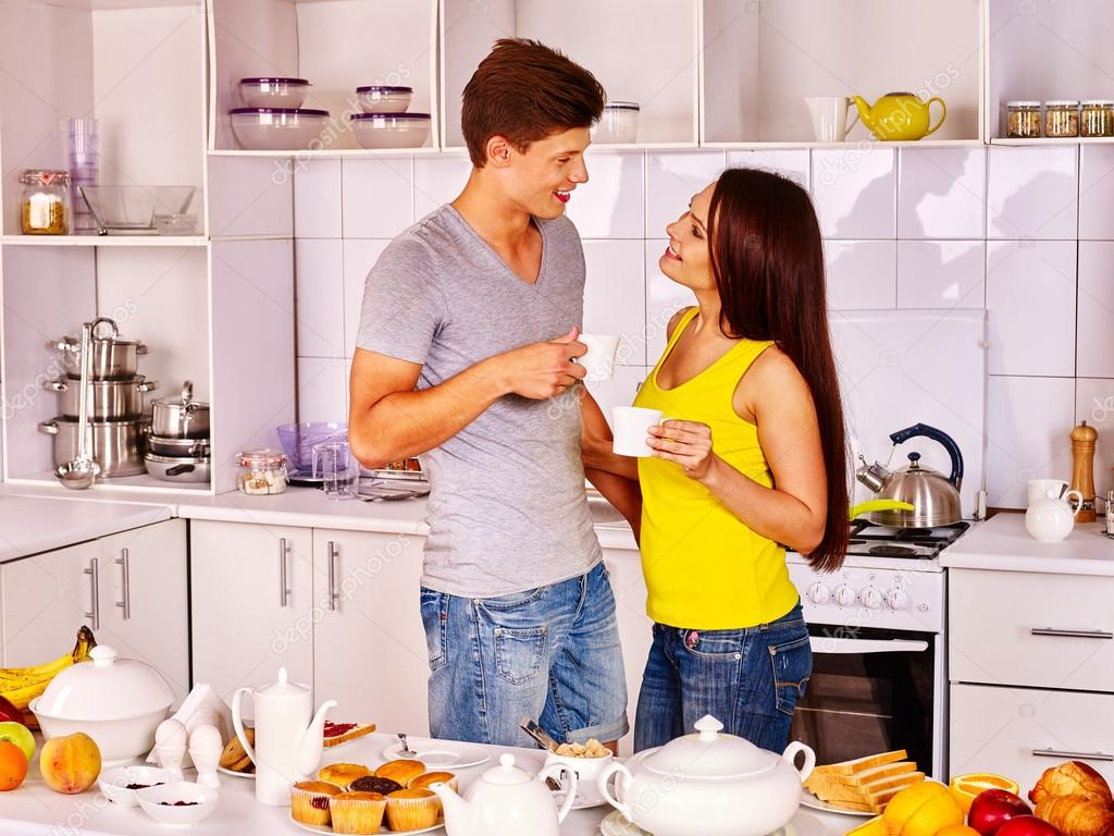 Depositphotos 75148457 stock photo couple breakfast at kitchen