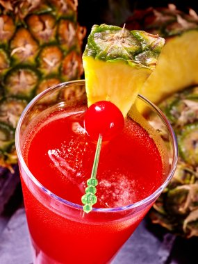 Red  drink  with cherry and pineapple