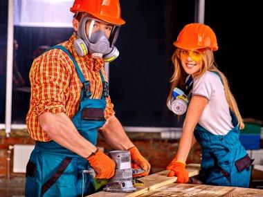 People in builder helmets