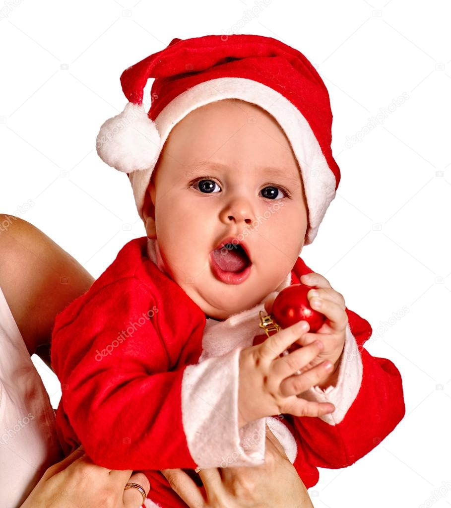 Baby boy clothing for Santa hats holding Christmas ball. — Stock ...
