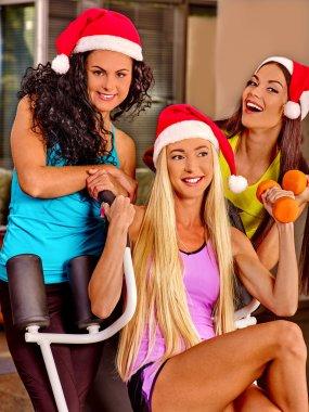 Girls holding dumbbells in sport gym.