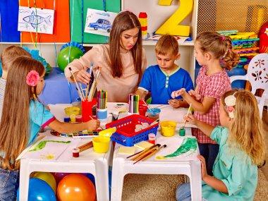 Group children with teacher in  preschool  kindergarten .