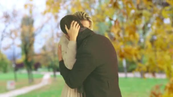 Man and woman  kissing beautiful in autumn park outdoor.