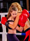 Portrait of sport girl boxing.