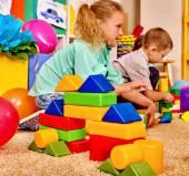 Fotografie Group children game blocks on floor .