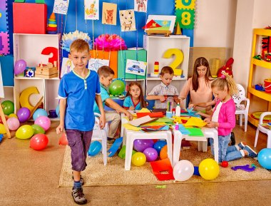 Group kids in preschool interior