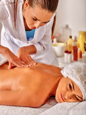 Woman middle-aged in spa salon with beautician.