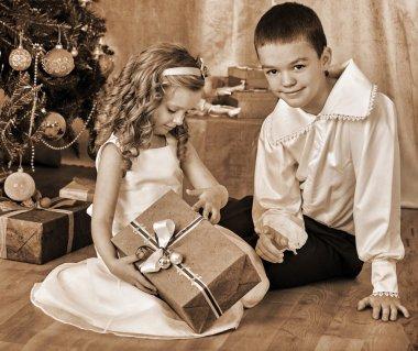 Happy children open gifts