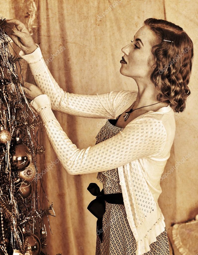 woman dressing Christmas tree — Stock Photo © poznyakov #90692572