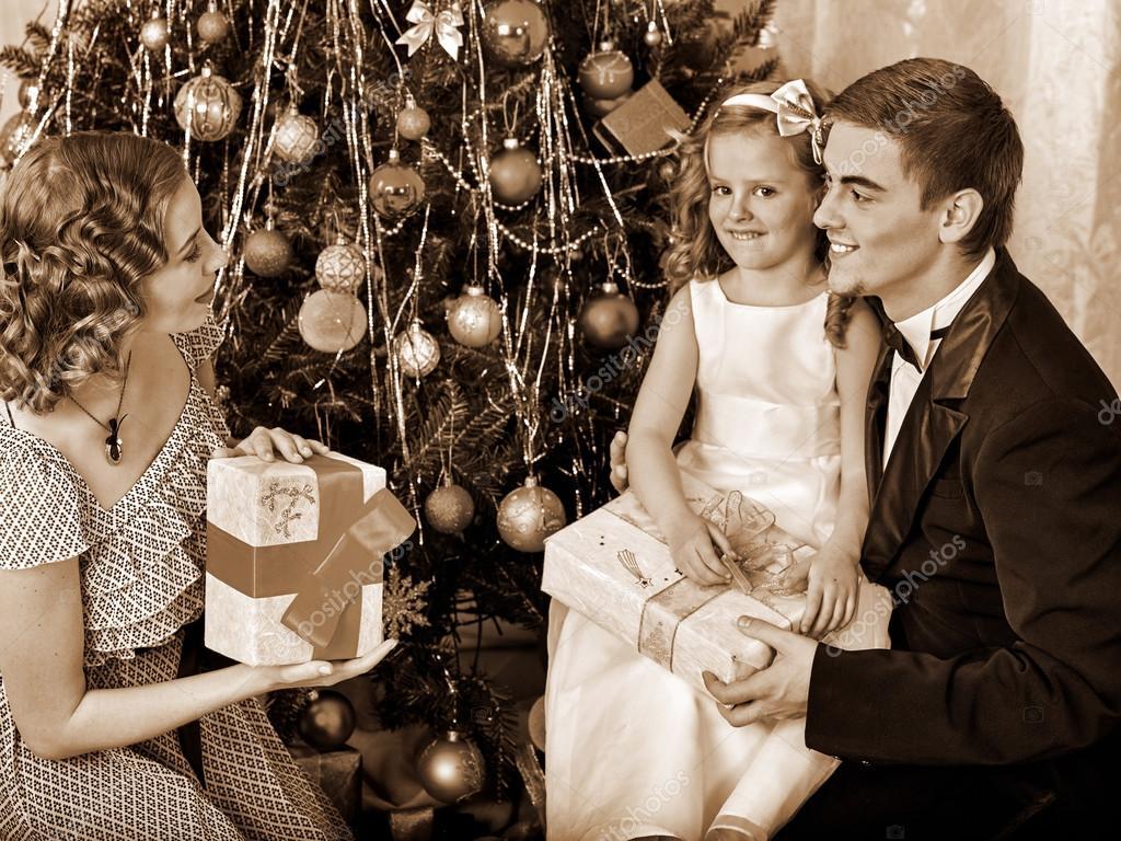 Family dressing Christmas tree — Stock Photo © poznyakov #90693068