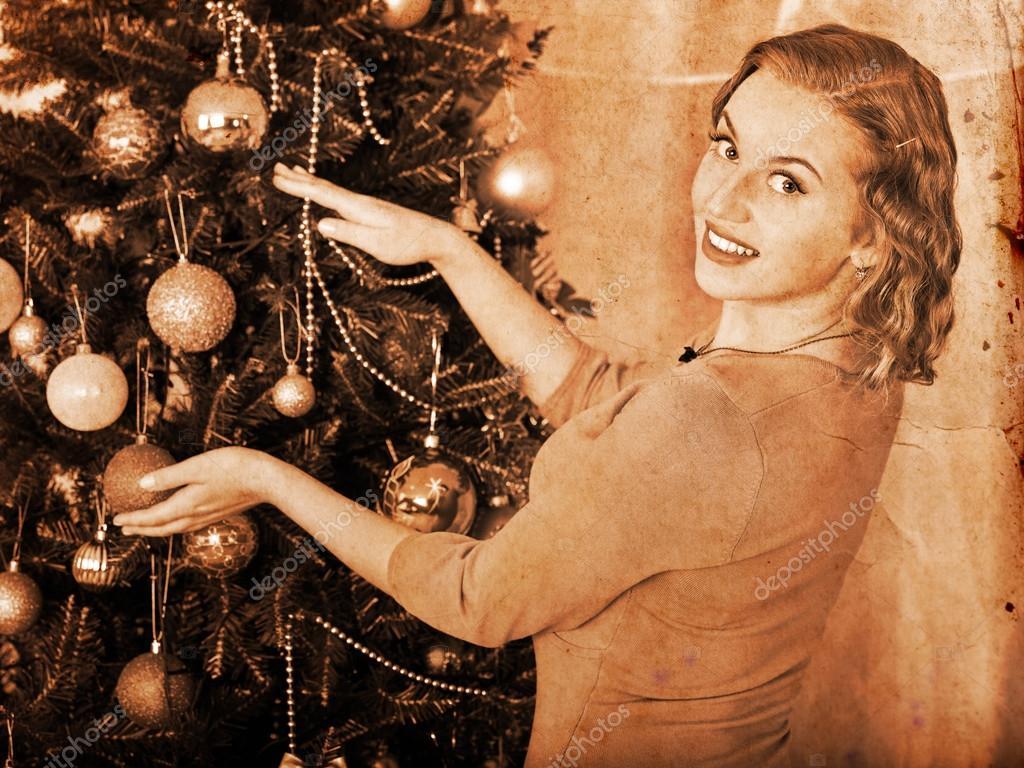 young woman dressing Christmas tree — Stock Photo © poznyakov ...
