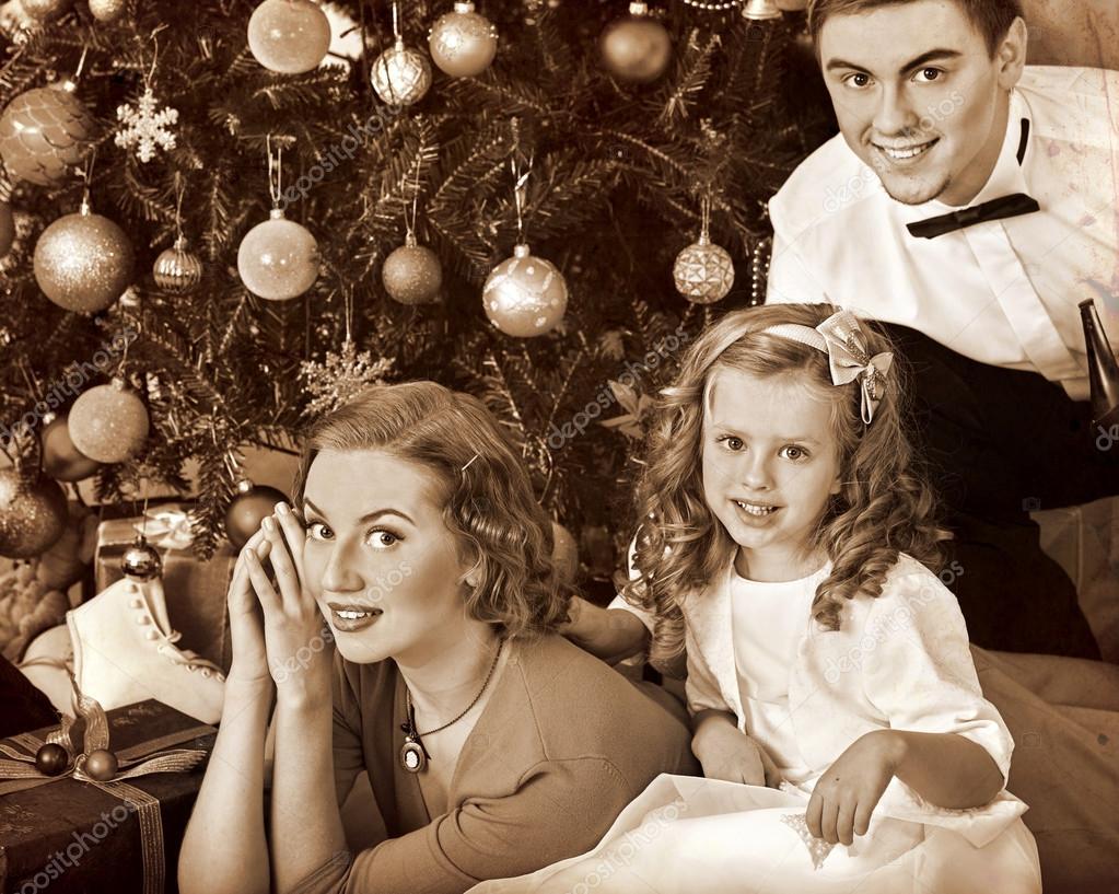 Family dressing Christmas tree — Stock Photo © poznyakov #90694372