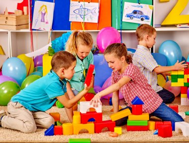 children building blocks in kindergarten