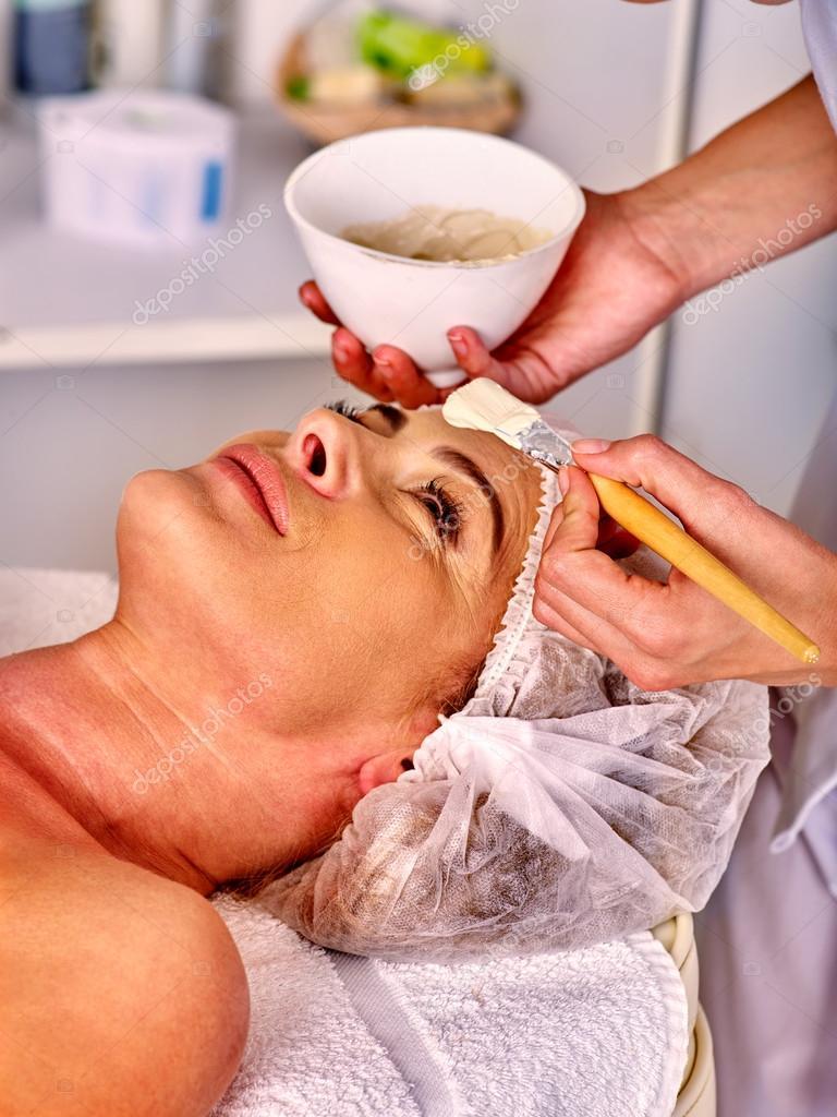 Woman take facial mask