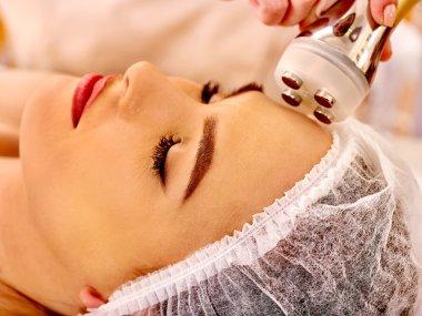 woman receiving electroporation facial therapy