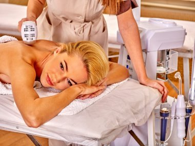 woman receiving electric back massage