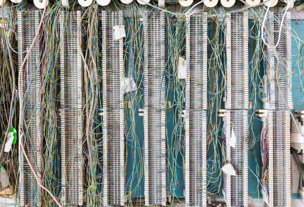 Telephone wiring panel on wall for telecoms — Stock Photo ... on telephone equipment, cable wiring, telephone handset holder, telephone plugs, telephone transmitter, telephone components, telephone computer, telephone tools, telephone switch, telephone number, telephone systems, data wiring, telephone design, telephone diagram, telephone blue, telephone cables, computer network wiring, telephone connectors, telephone relay, telephone wires, telephone schematic, computer wiring, telephone service, low voltage wiring, electrical wiring, telephone jacks, telephone panel board, telephone repair, telephone communication system, telephone data lines, telephone line work, telephone installation, telephone operators,