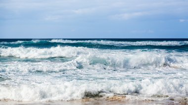 Rows of waves coming to shore