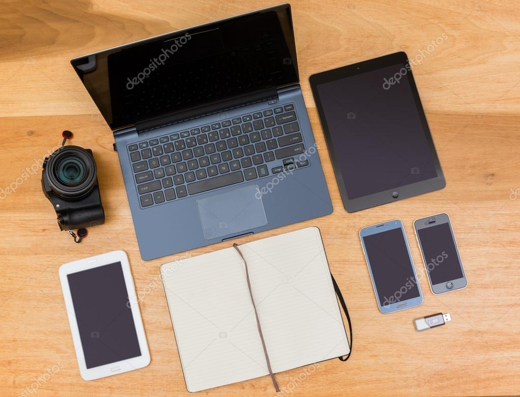 overhead top view of wooden desk with computing gear stock photo