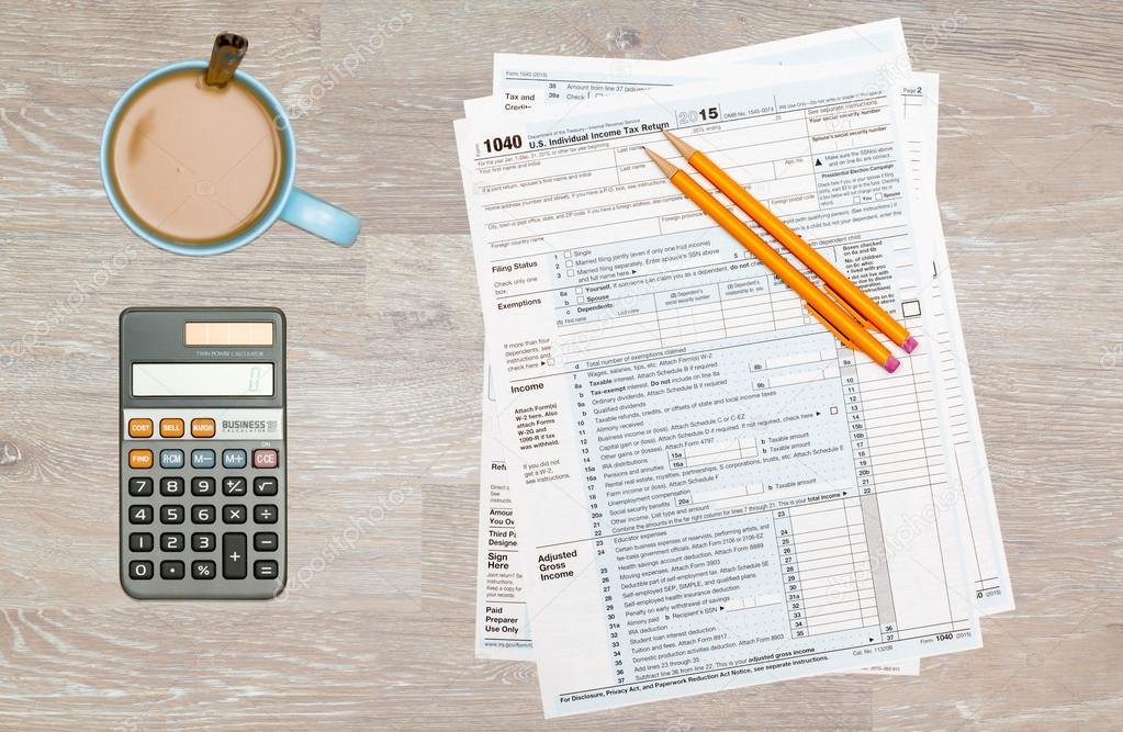 Coffee And Calculator On 2014 Irs Form 1040 Stock Photo
