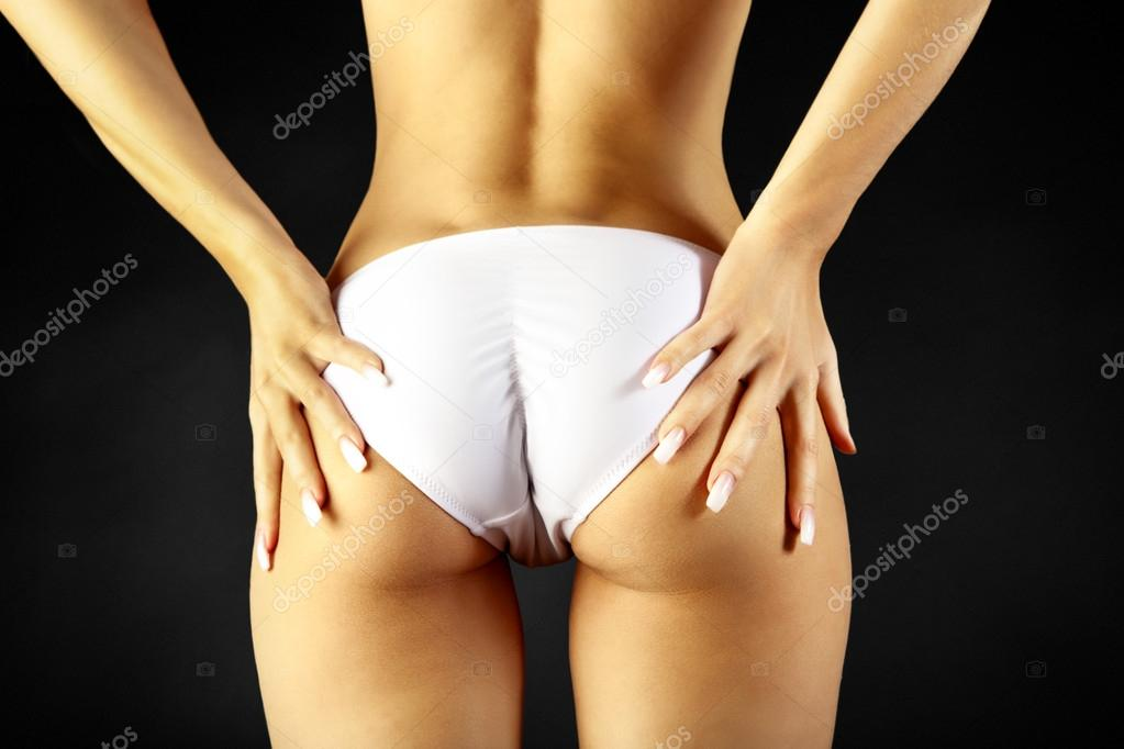 Woman take off her panties.