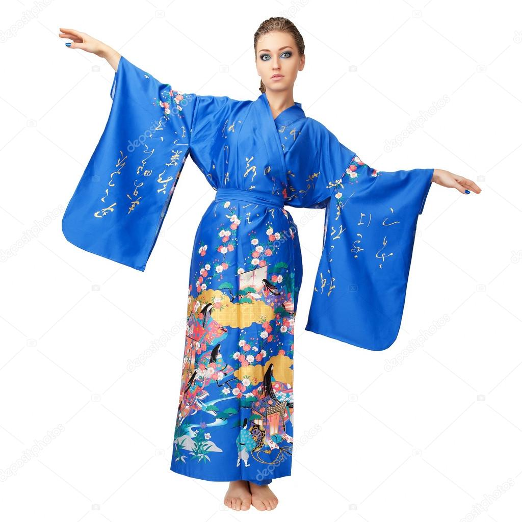 b6d2090b9 Attractive young woman in traditional clothes looking at you