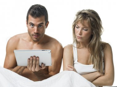 uncommunicative couple on bed in white