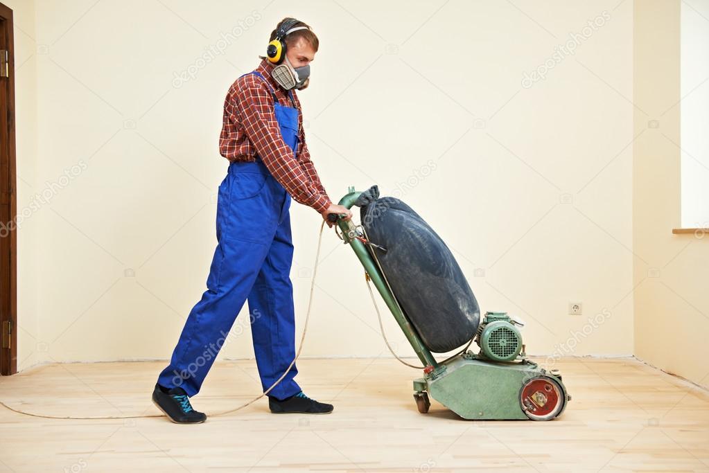 Parket vloer onderhoud door schuurmachine u stockfoto kalinovsky