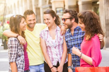 Group of friends meeting in the city. They are young and happy, and they could be tourists or students. The photo was taken in Pisa, Italy, but could also be used for Rome, Florence or Milan. stock vector