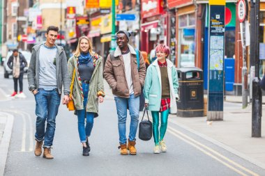 Group of young friends walking in London