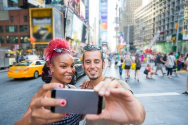 Young Couple Taking Selfie in Times Square