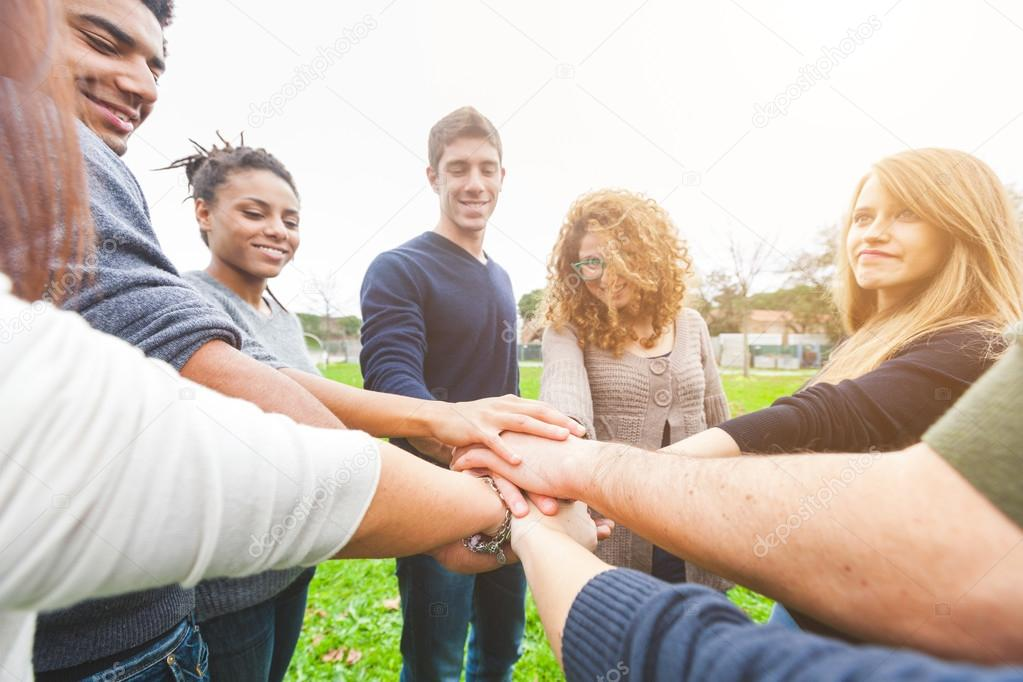 Multiracial Group of Friends with Hands in Stack, Teamwork