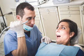 Photo Dentist Scaring Patient with the Drill.