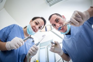 Dentists Holding Dental Tools Looking at Camera with Scary Faces