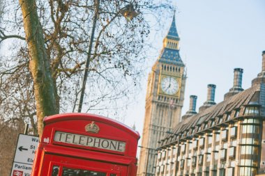 Famous red telephone box with Big Ben on background